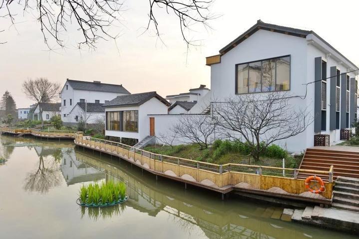 """""""桃园村村民周雪康告诉记者,和现在流行的欧式建筑风格相比,他们更图片"""
